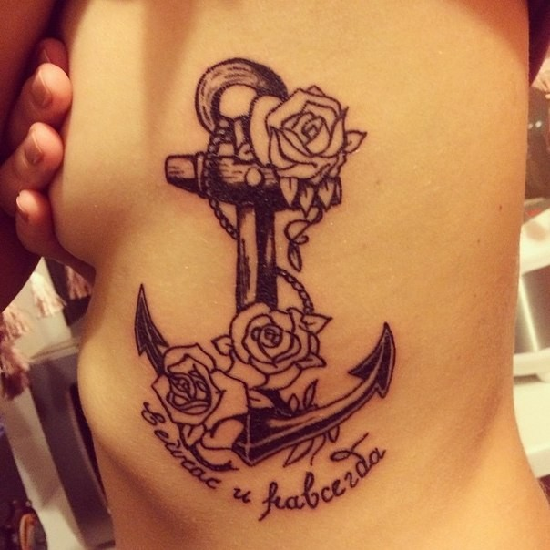 Black-and-white anchor with roses and signs tattoo on rib-side