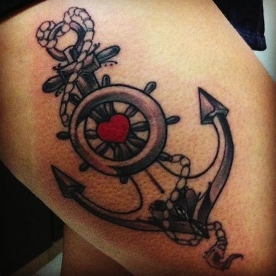 Black-and-white anchor with wheel and red heart tattoo on thigh