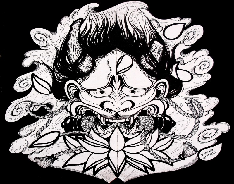 Black-and-white devil face with a scroll in teeth under lotus flower tattoo design
