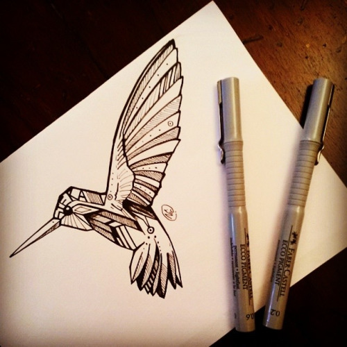 Black-and-white flying hummingbird with geometric effect tattoo design