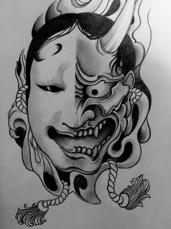 Black-and-white half- human mask half-devil with ropes tattoo design