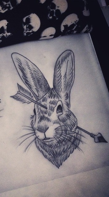 Black-and-white hare head killed with arrow tattoo design