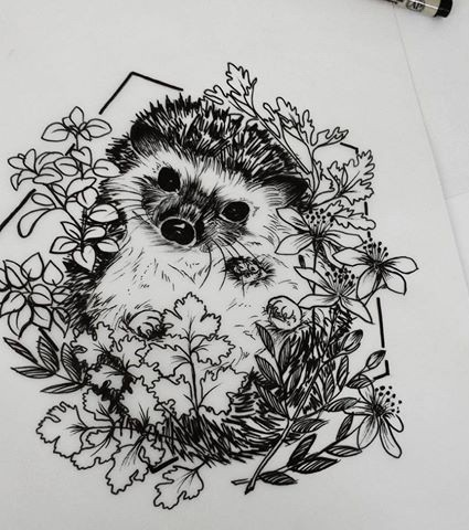 Black-and-white hedgehog surrounded with flowers and leaves in pentagon frame tattoo design