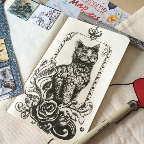Black-and-white imperial cat in floral frame tattoo design