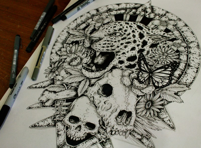Black-and-white jaguar head with skulls on mandala background tattoo design by The Freaks World