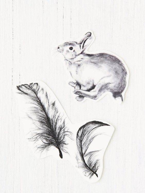 Black-and-white jumping hare and big falling feathers tattoo design