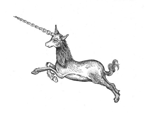 Black-and-white jumping unicorn with long drill horn tattoo design
