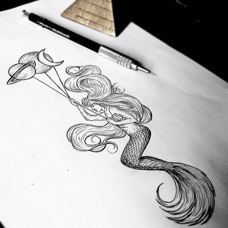Black-and-white mermaid with planet-shaped balloons tattoo design