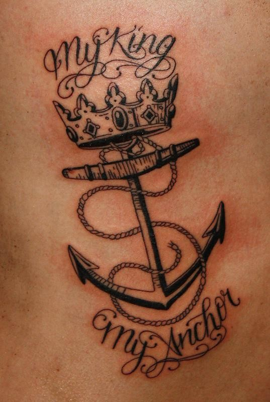 Black-and-white neutral anchor with crown and lettering tattoo on rib-side