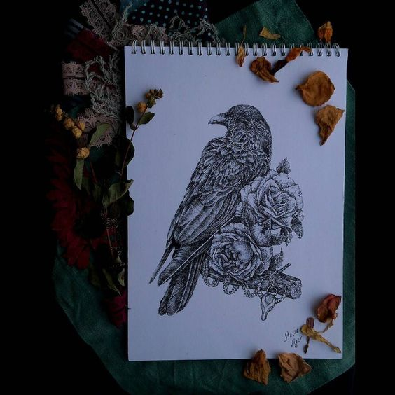 Black-and-white raven sitting on flowered branch tattoo design