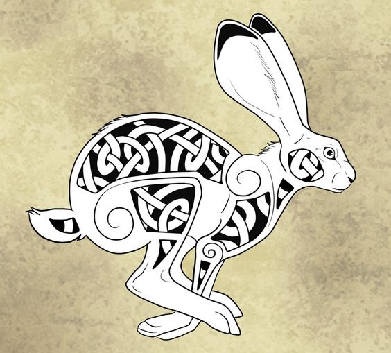 Black-and-white running hare with celtic pattern tattoo design