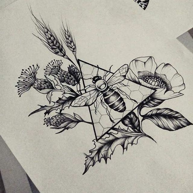 black ink bee on honeycomb patterned triangle surrounded with poppy