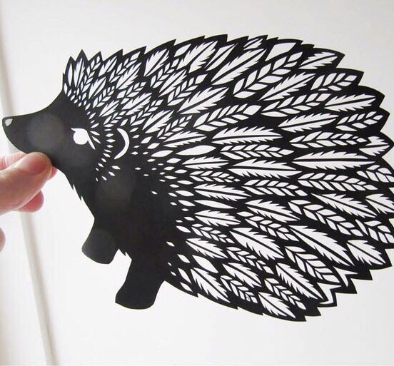 Black-ink hedgehog with feather spines tattoo design
