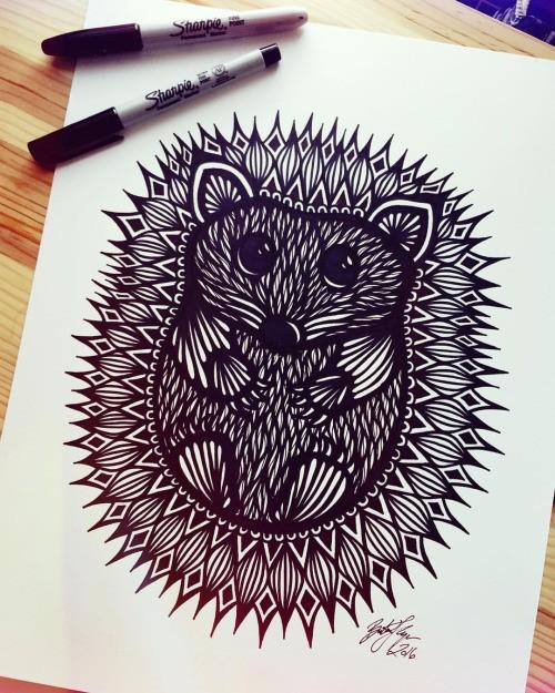 Black-ink hedgehog with ornate spines tattoo design