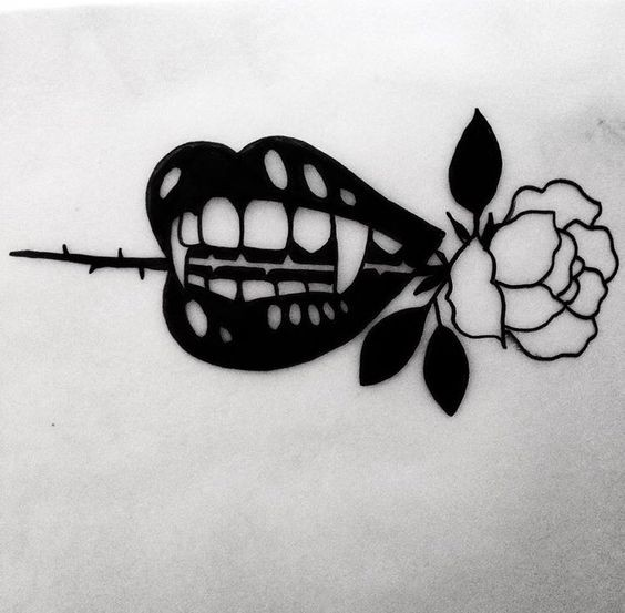 Black-ink vampire mouth keeping a rose stem in teeth tattoo design