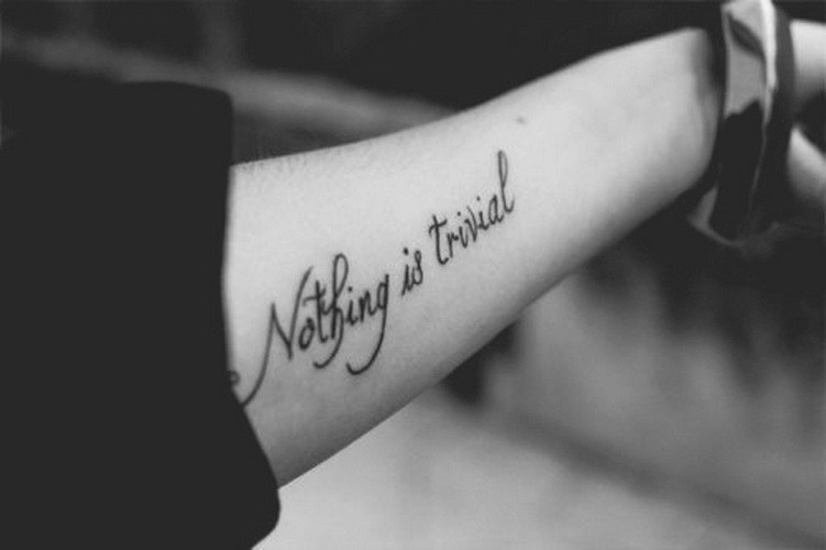 Black-lettered nothing is trivial quote tattoo on arm