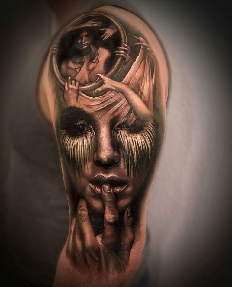 Black and gray style detailed upper arm tattoo of creepy woman with portrait