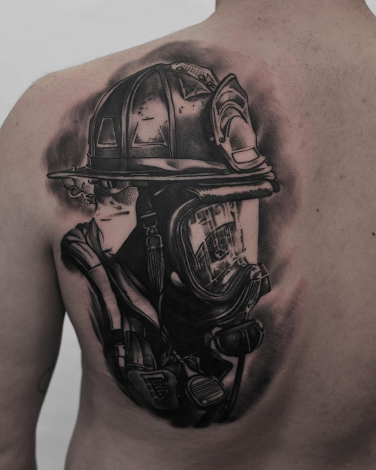 Black and white Firefighter tattoo on back