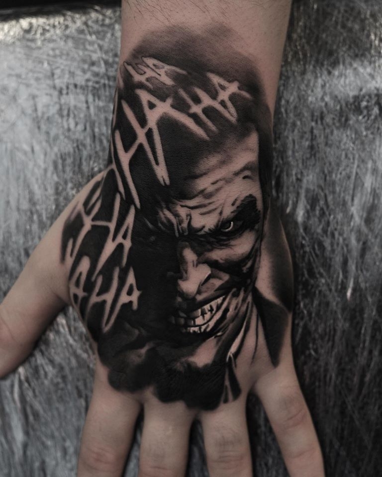 Black and white Joker tattoo on wrist