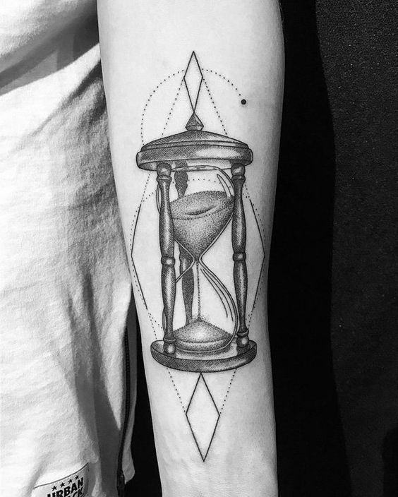 Black dotwork hourglass forearm tattoo