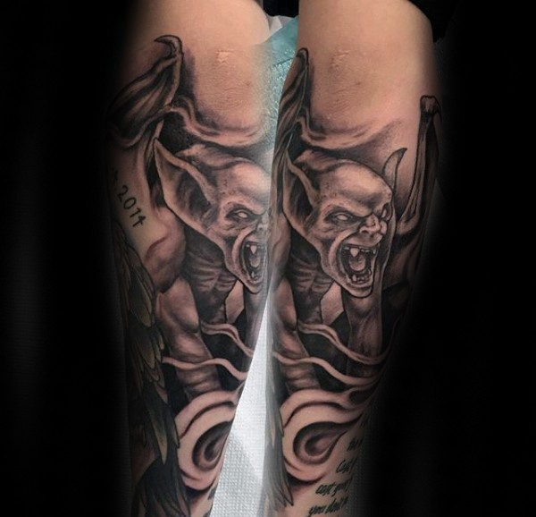 Black ink old school style half sleeve tattoo of demonic gargoyle and lettering