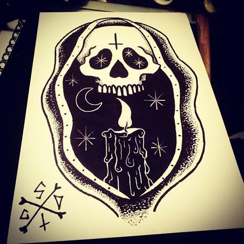 Black old school death skull and shining candle on night background tattoo design