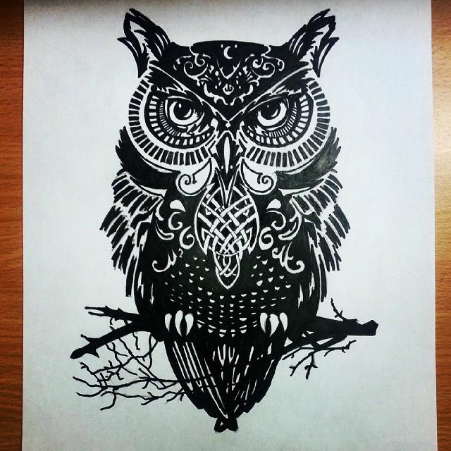 Black owl sitting on tree branch tattoo design