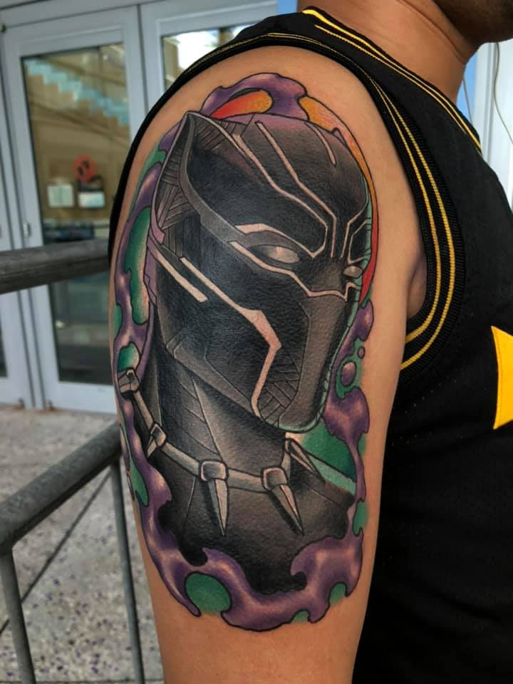 Black panther tattoo on shoulder