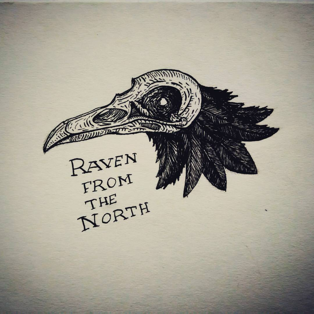 Black raven head in skull with lettering tattoo design