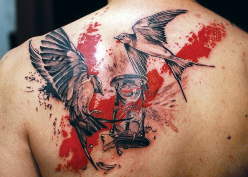 Black red birds with hourglass trash polka tattoo on back