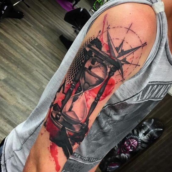 Black red trash polka hourglass tattooo on shoulder