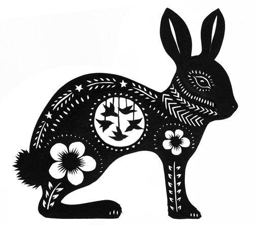 Black static hare with white ornament tattoo design