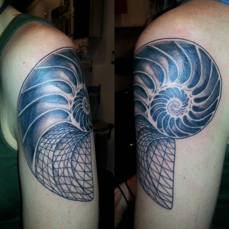 Blackwork style large upper arm tattoo of nautilus shell