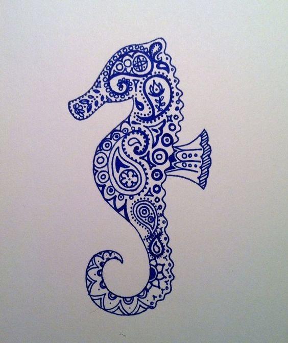Blue-ink folk-patterned seahorse tattoo design
