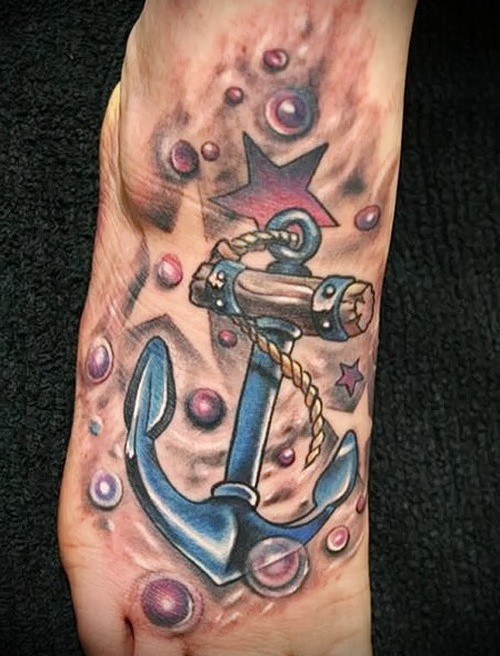 Blue anchor with red star and bubbles tattoo on foot