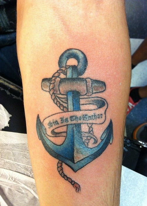 Blue anchor with ribbon lettering tattoo on forearm