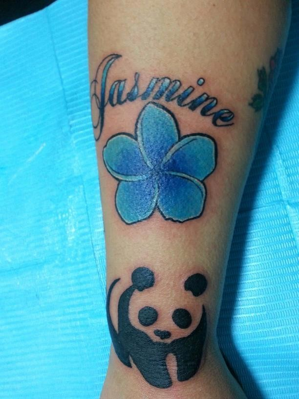 Blue jasmine flower with panda and quote tattoo on arm