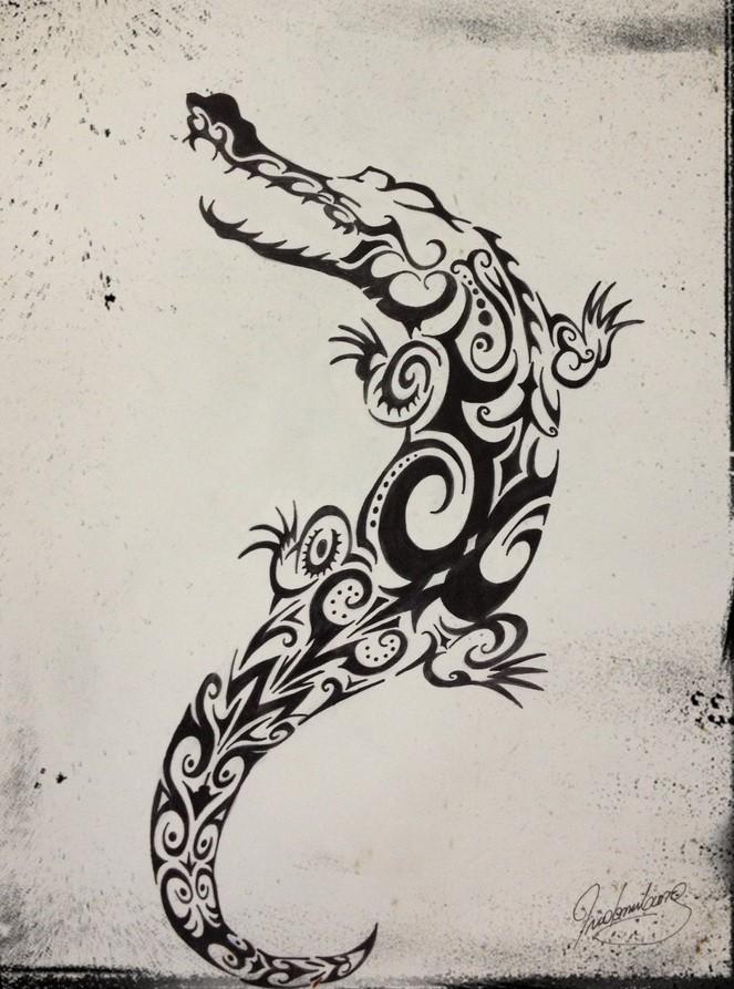 Bonny black tribal reptile crawling up tattoo design