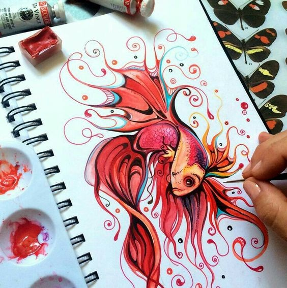 Bonny red gold fish with swirly flippers tattoo design