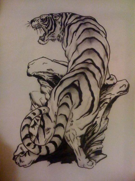 brave black and white tiger standing on stones pile tattoo design. Black Bedroom Furniture Sets. Home Design Ideas