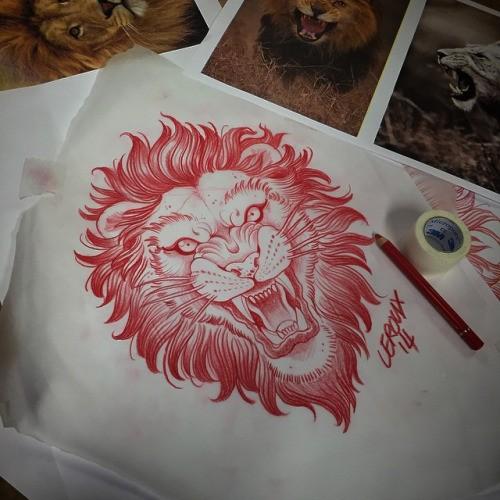 Brave red-ink roaring wild animal face tattoo design