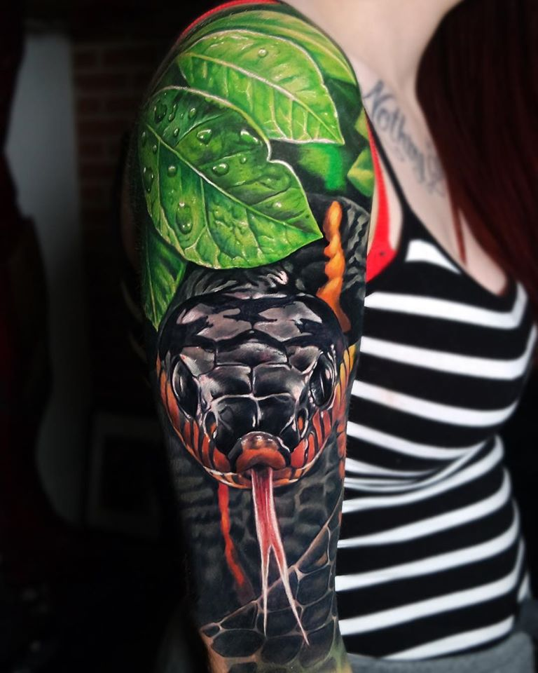Bright snake tattoo on shoulder
