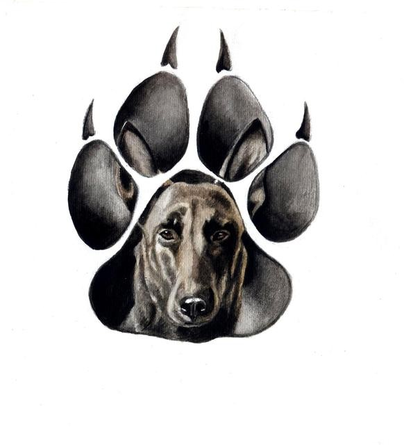 Calm dog face in paw trace tattoo design