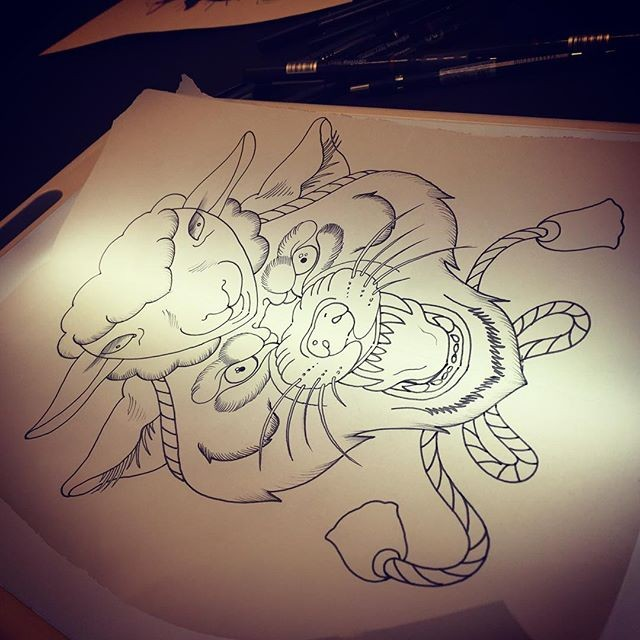 Cartoon outline sheep and wolf head with rope tattoo design