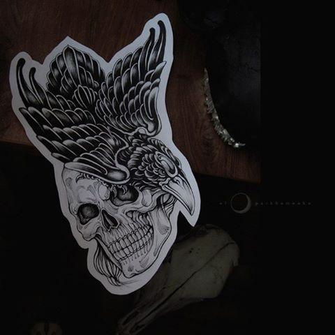 Cartoon raven sitting on skull tattoo design