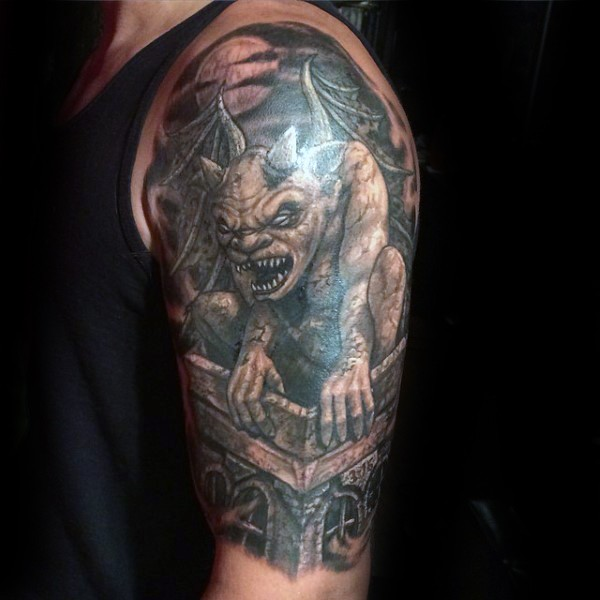 Cartoon style colored upper arm tattoo of evil statue