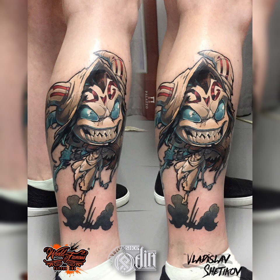 Cartoon style tattoo on leg