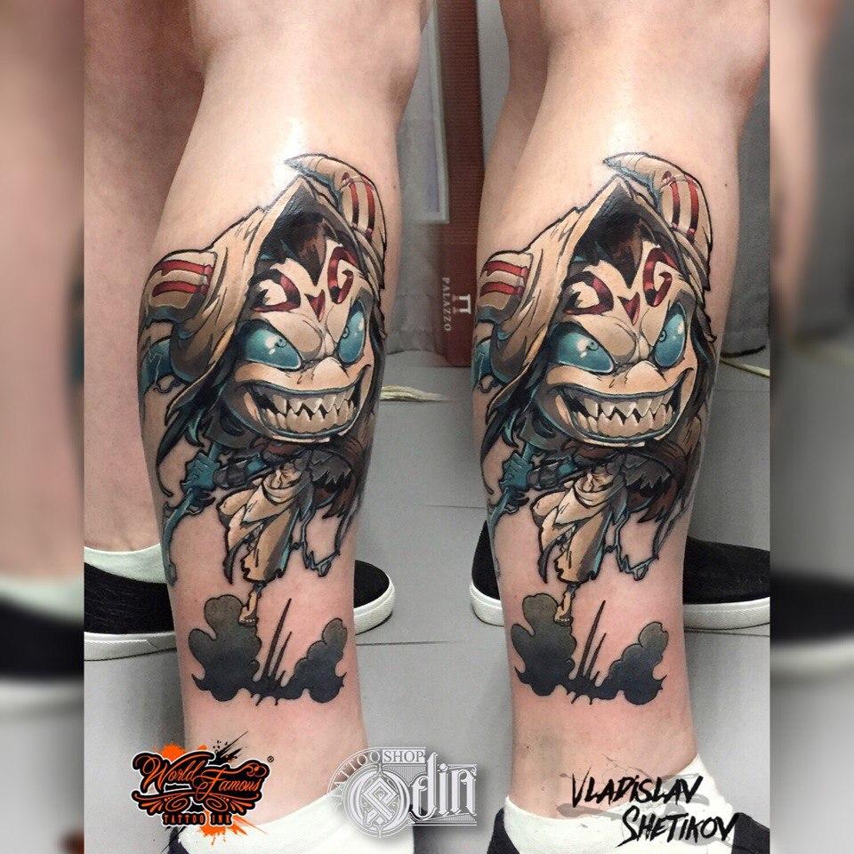 Cartoon style tattoo on leg