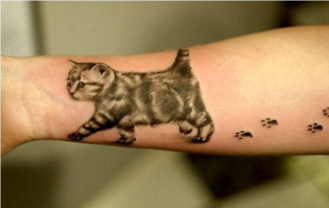 Walking kitten with paw prints tattoo on wrist