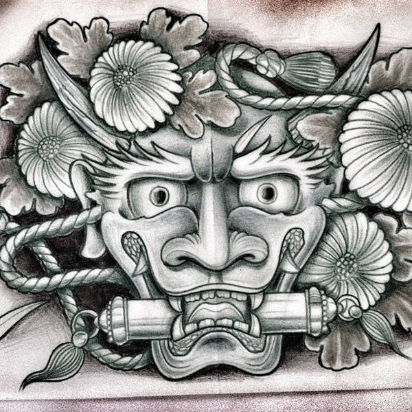 Cheerful grey devil face with a scroll in teeth tattoo design